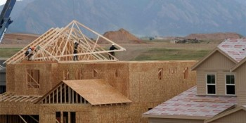 Workers install roof trusses onto a new house in Arvada, Colorado July 10, 2017. REUTERS/Rick Wilking